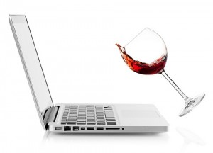Wine falling on laptop